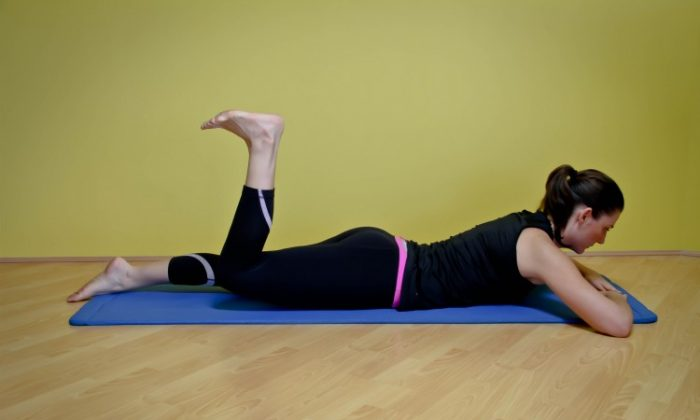 The lying heel press strengthens the hamstrings, glutes, and lower-back muscles and lengthens the hip flexors. (Jocelyn Bong)