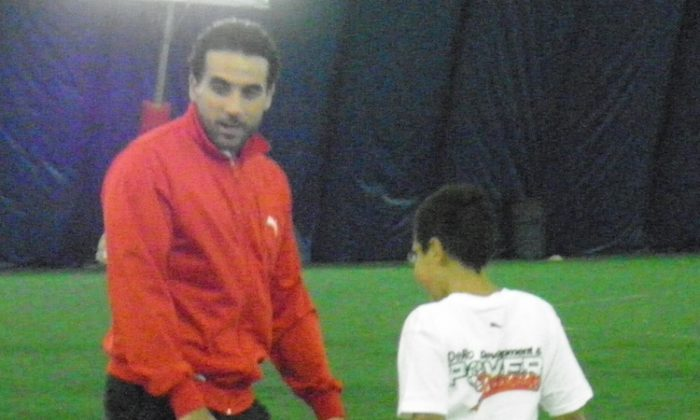Dwayne De Rosario explains a dribbling drill to a young kid at the Algonquin College Soccer Facility on Sunday, Jan. 13, 2013, in Ottawa. (Rahul Vaidyanath/The Epoch Times)