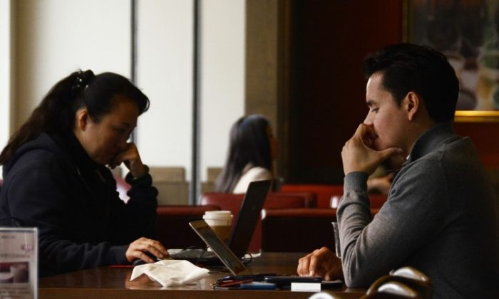 People in Beijing use their laptops at a cafe in Beijing in November, 2012. (Wang Zhao/AFP/Getty Images)