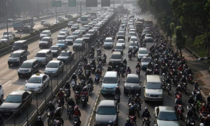 Commuter vehicles are gridlocked during rush hour traffic in Jakarta on Sept. 7, 2012. Subsidies help produce such congestion, says Will Hickey.(Bay Ismoyo/AFP/Getty Images)