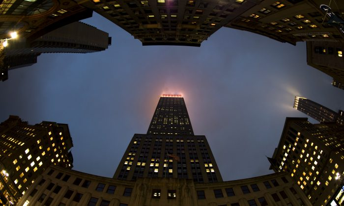 The lights of the Empire State Building illuminate the fog January 16, 2013 in New York. (DON EMMERT/AFP/Getty Images)