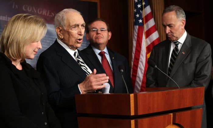 Sen. Robert Menendez (D-NJ), and Sen. Charles Schumer (D-NY) listen during a news conference  on Capitol Hill in January. Officials who support a proposed gun control bill are concerned the ailing Lautenberg might not be in D.C. to vote. (Alex Wong/Getty Images)