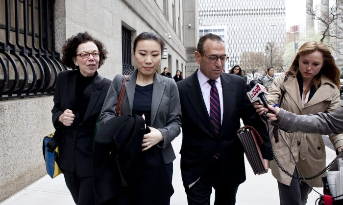 Comptroller John Liu's treasurer, Jenny Hou (C) exits the the United States District Court in Manhattan with her lawyers Jarold Lefcart (R) , Sheiyrl Reich (L) in New York on April 16. (Samira Bouaou/The Epoch Times)