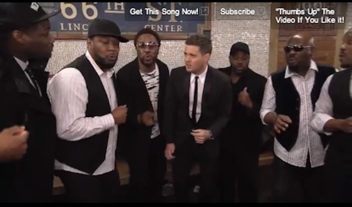 Screen capture of a YouTube video capturing Canadian singer Michael Buble giving an impromptu performance on the New York City subway station below the Lincoln Center.