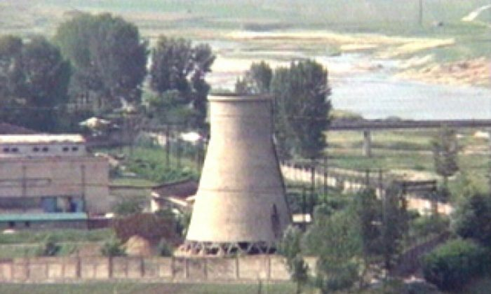 FILE - In this June 27, 2008 file photo from television, the 60-foot-tall cooling tower is seen before its demolition at the main Nyongbyon reactor complex in Nyongbyon, also known as Yongbyon, North Korea. (AP Photo/APTN, File)
