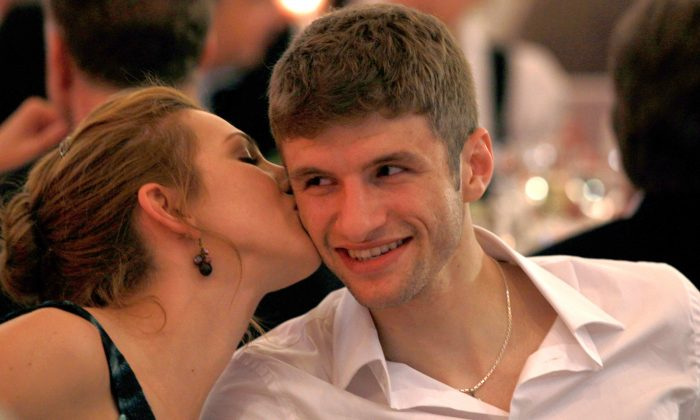 Thomas Mueller of Bayern Muenchen smiles with his wife Lisa Mueller during the Champions League banquett on May 22, 2010 in Madrid, Spain. ( Alexander Hassenstein/Bongarts/Getty Images)