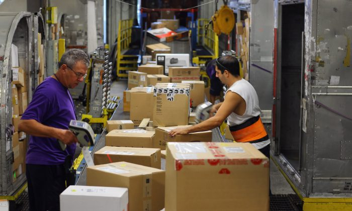 Workers pack parcels for delivery to online shoppers. A sales tax on online shopping will bring in much needed revenue says supporters of a bill that will allow states to require internet retailers to collect sales tax causing states to lose revenue (Joe Raedle/Getty Images)