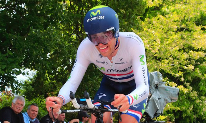 Movistar's Alex Dowsett, wearing his British Champion's jersey, rides hard during the Stage Eight time trial of the 2013 Giro d'Italia. (movistarteam.com)