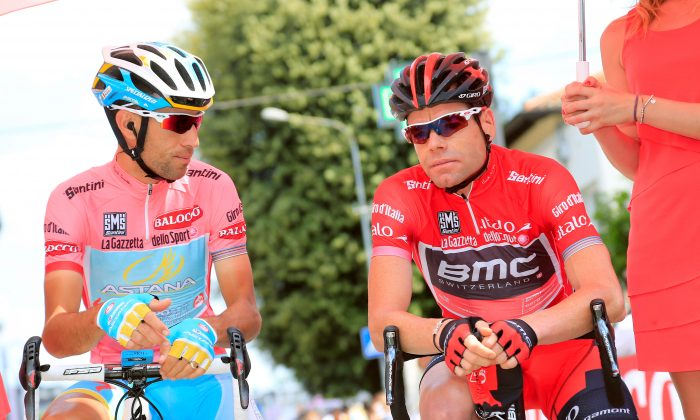 Astana's Vincenzo Nibali (L) and BMC's Cadel Evans, in first and second place, talk before the start of the 10th stage of the 96th Giro d'Italia, May 14, 2013 in Cordenons. (Luk Benies/AFP/Getty Images)