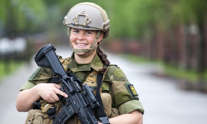 Kjersti Sandvik, 20, a soldier in the Norwegian Royal Guard, in Oslo, Norway, on May 23, 2013. Sandvik voluntarily joined the Guard, but Norway is now considering extending its universal conscription to women as well as men. (Thomas Iversen/The Norwegian Army)