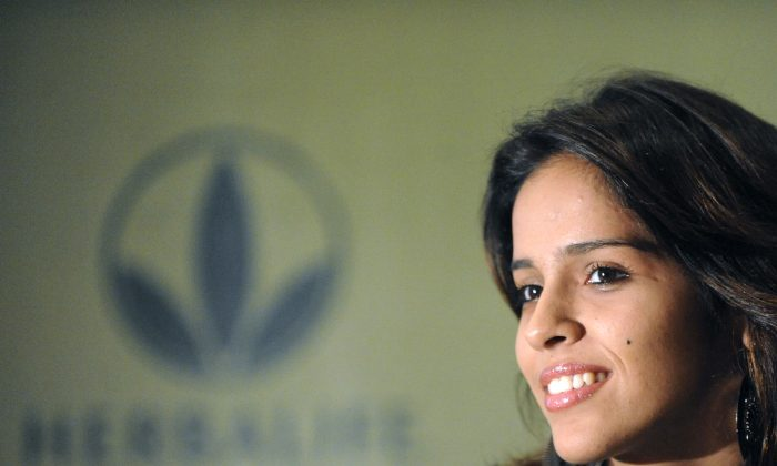 In this 2010 file photo, Indian badminton player Saina Nehwal poses at a Herbalife press conference in Hyderabad, India. In the past year, Herbalife Ltd. has faced repeated accusations of being a pyramid scheme. (Noah Seelam/AFP/Getty Images) (Noah Seelam/AFP/Getty Images)