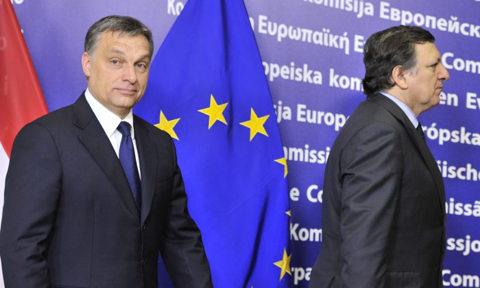 European Commission President José Manuel Barroso (R) and Hungarian Prime Minister Viktor Orban arrive for a working session at the European Union Headquarters in Brussels on Jan. 24, 2012. Orban sought a way out of a row with Brussels over controversial new laws that have set off EU legal action. (Georges Gobet/AFP/Getty Images)