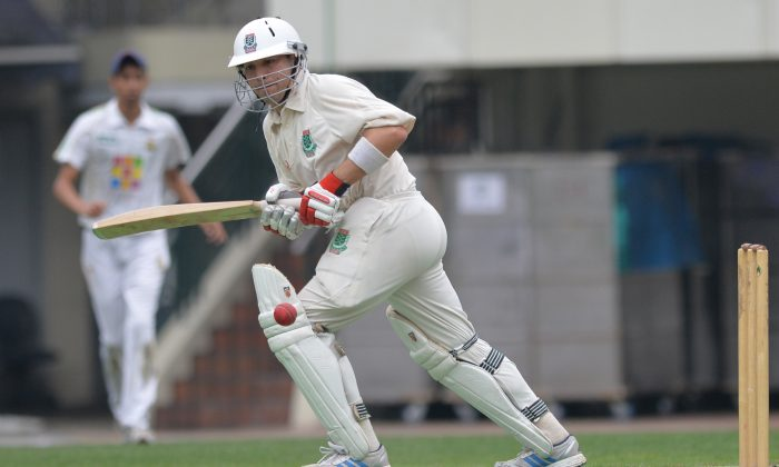 Dylan Dearing turns a ball to leg during his innings of 96 for KCC against LSW Cricket Club in the 2-Day Premier League match on Sunday April 28. KCC won the match by nine wickets to become the Hong Kong Cricket Association Pemier 2-Day Champions. (Bill Cox/The Epoch Times)
