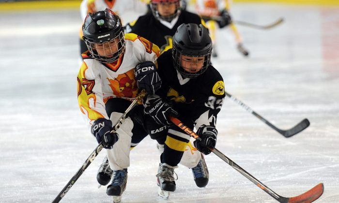 Children under the age of 6 compete in Hong Kong ... Beijing Little Wolf A (black) beat Beijing Red Devils in the Mega Ice Hockey 5's Atoms Final on Saturday May 4. (Mega Ice)