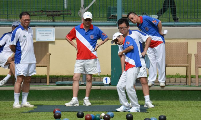 Both the Hong Kong Football Club (in white) and Kowloon Bowling Green Club members get anxious during the Premier League encounter. KBGC emerged with a 6:2 victory. (Stephanie Worth)