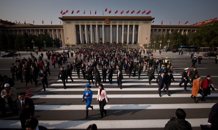 Delegates leave after the opening session of the Chinese Communist Party's five-yearly Congress at the Great Hall of the People in Beijing on Nov. 8, 2012. A Chinese academic says the regime needs to drastically cut its bloated membership to avoid losing power, like the Soviet Communist Party. (Ed Jones/AFP/Getty Images)