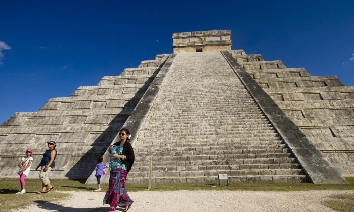 Tourists are seen at Chichen Itza archaeological park, in Yucatan state, Mexico, on Dec. 20, 2012.  (Pedro Pardo/AFP/Getty Images)