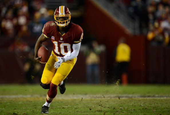 Robert Griffin III of the Washington Redskins runs the ball against the Seattle Seahawks during the NFC Wild Card Playoff Game at FedExField on January 6, 2013 in Landover, Maryland. (Patrick McDermott/Getty Images)