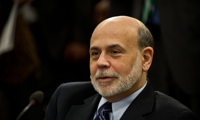 U.S. Federal Reserve Chairman Ben Bernanke waits for the start of the International Monetary and Financial Committee (IMFC) meeting during the 2013 World Bank/IMF Spring meetings in Washington on April 20. (Nicholas Kamm/AFP/Getty Images)