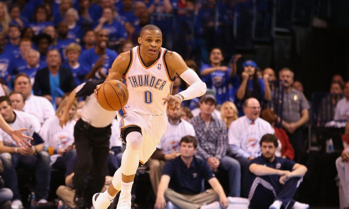 Russell Westbrook #0 of the Oklahoma City Thunder handles the ball during Game Two of the Western Conference Quarterfinals of the 2013 NBA Playoffs against the Houston Rockets at Chesapeake Energy Arena on April 24, 2013 in Oklahoma City, Oklahoma.(Christian Petersen/Getty Images)