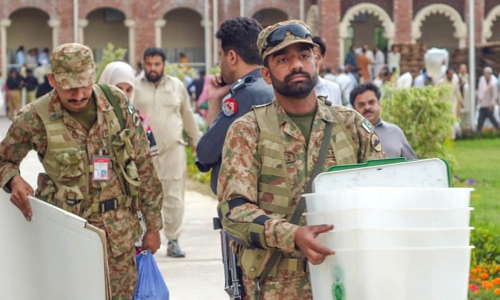 Pakistani army soldiers carry electoral materials in Rawalpindi on May 10, 2013. The Taliban on Friday stepped up their threats against Pakistan's landmark elections, warning voters to boycott polling stations to save their lives as bloody attacks targeted party offices. (Farooq Naeem /AFP/Getty Images)