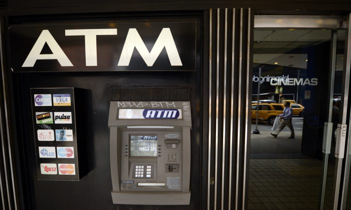 An ATM machine on Third Avenue is viewed in New York on May 10, 2013, just one of the many that were used as cyber thieves around the world stole $45 million by hacking into debit card companies, scrapping withdrawal limits and helping themselves from cash machines, U.S. authorities said May 9, 2013. (TIMOTHY A. CLARY/AFP/Getty Images)