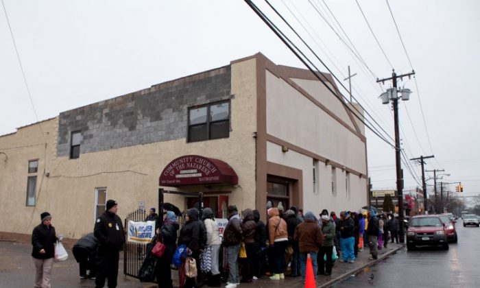 Far Rockaways residents line up for Hurricane Sandy disaster relief food and clothing at the Community Church of the Nazarene in Queens, New York, Jan. 16. (Samira Bouaou/The Epoch Times)