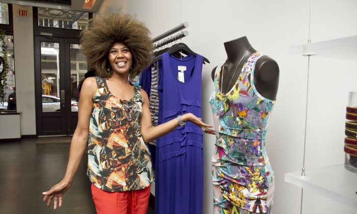 A shop attendant at the Nicole Miller store in SoHo shows off the designer's creations on the rack and on herself. Sixty percent of Nicole Miller clothes are made in New York City. (Samira Bouaou/The Epoch Times)
