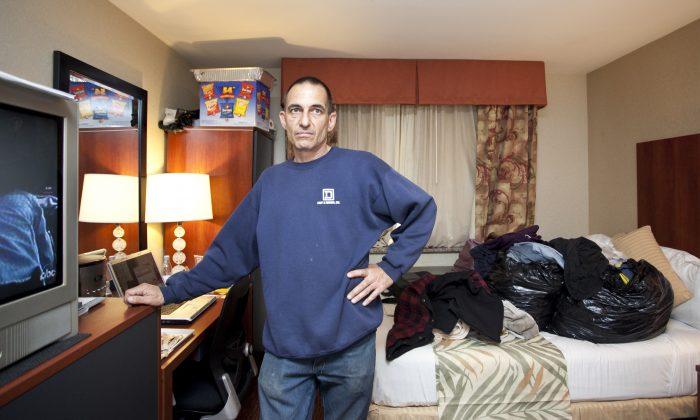 Richard Fabio, a Hurricane Sandy evacuee, in the Staten Island Ramada Inn. He has been living in a hotel since Dec. 22, 2012. (Samira Bouaou/The Epoch Times)