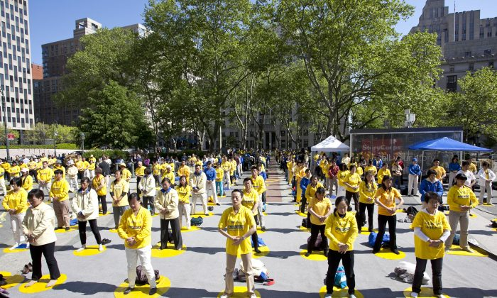 Falun Dafa practitioners in Lower Manhattan's Foley Square demonstrating the gentle Falun Dafa exercises on May 12. Practitioners gathered in honor of World Falun Dafa Day, which falls on May 13 and marks the day the spiritual practice based on truthfulness, compassion and tolerance was introduced to the public in China. (Samira Bouaou/The Epoch Times)