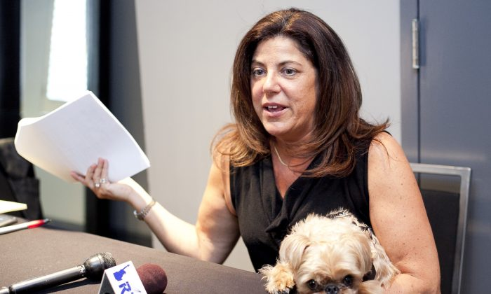 Attorney Susan Chana Lask speaks to reporters while holding Umka, a Brussels Griffon. Lask is representing Umka's owner, Elena Zakharova, in a lawsuit against the state Department of Agriculture. (Samira Bouaou/Epoch Times)