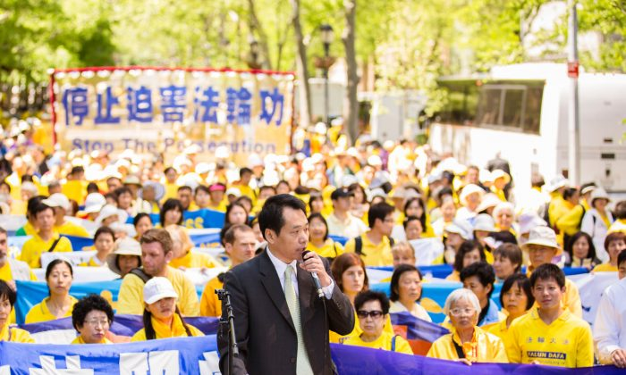Baiqiao Tang, chairman of China Peace, and a leading Chinese dissident, speaks at a rally calling for an end to the persecution of Falun Gong in China in front of the United Nations building in New York City on May 17, 2013. (Edward Dai/The Epoch Times)