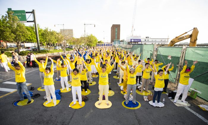 Falun Dafa practitioners protest peacefully in front of the Chinese Consulate General in New York on May 17, calling for an end to the persecution of the practice in China. (Edward Dai/The Epoch Times)