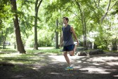 Brendan Brazier, founder of thriveforward.com, stretches in Central Park, New York on May 21. (Samira Bouaou/The Epoch Times)