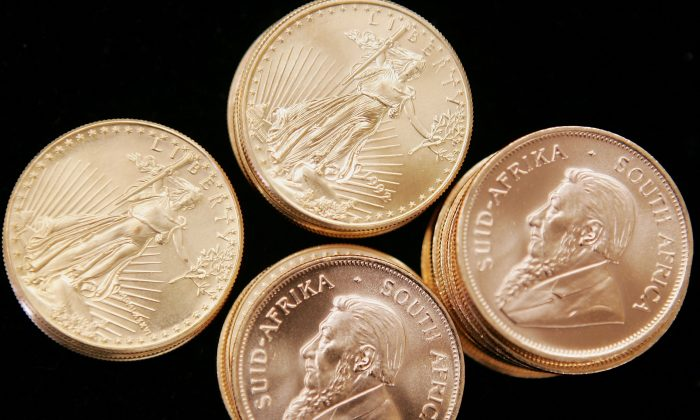 American Eagle and South African Krugerrand gold bullion is offered for sale at the Chicago Coin Company in Chicago, Ill. China has stepped up gold imports and production but  the rest of world does not know how much gold the country owns. (Scott Olson/Getty Images)