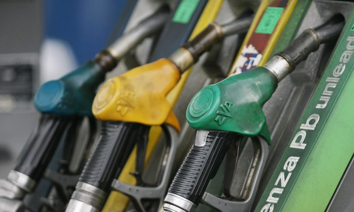 Gasoline pumps are pictured at a gas station in Italy. The European Commission is investigating concerns that companies have colluded to manipulate oil price reporting. (Mario Laporta/AFP/Getty Images)