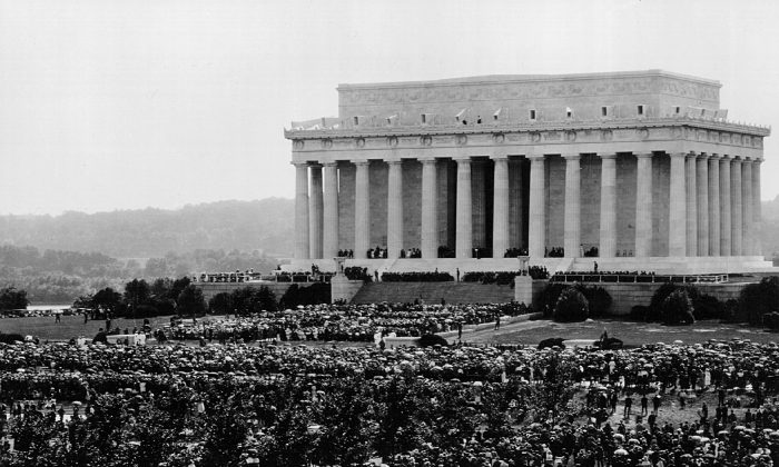 Crowds gather outside the Lincoln Memorial for a Memorial Day dedication in 1922 in Washington DC. (Photo by National Archives/Newsmakers)