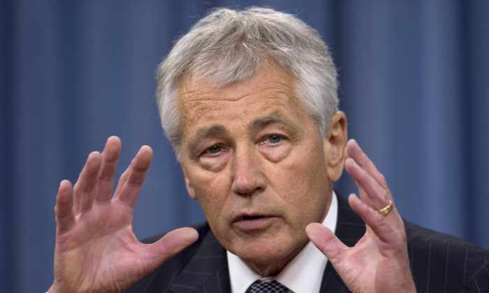 Defense Secretary Chuck Hagel gestures as he speaks during a news conference at the Pentagon, Friday, May 17, 2013. He told reporters on May 30 that civilian Department of Defense workers face summer furloughs and reduced pay. (AP Photo/Carolyn Kaster)
