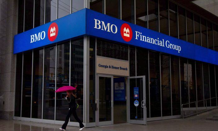 A woman leaves a Bank of Montreal branch in downtown Vancouver, B.C., on March 22, 2011. BMO Financial Group has added its voice to a chorus of Canadian banks that say they must control expenses during the current period of sluggish consumer lending. (THE CANADIAN PRESS/Darryl Dyck)