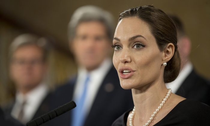 Actress Angelina Jolie, in her role as UN envoy, talks during a news conference regarding sexual violence against women in conflict, at the Foreign Ministers G8 meeting in Lancaster House on April 11, 2013 in London, England. Jolie's revelation on May 14 that she had undergone a double mastectomy in order to prevent cancer has spurred women in Shanghai, China to become much more interested in being checked for possible breast cancer. (Alistair Grant - WPA Pool/Getty Images)