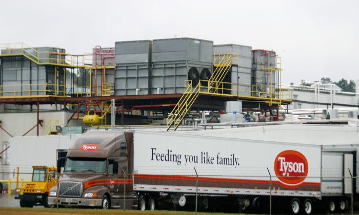 A Tyson Poultry truck backs up to its loading dock at a processing plant in Carthage, Tex. Agriculture Secretary Tom Vilsack is pushing for a new poultry processing rule, but critics say the measure endangers public health and workers' rights. (Mario Villafuerte/Getty Images)