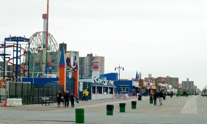 People walk along the boardwalk near Luna Park at Coney Island, New York, on March 24. With the beaches opening and Luna Park fully opening for Memorial Day weekend, repairs to damage caused by Hurricane Sandy at the amusement park are wrapping up. (Joshua Philipp/The Epoch Times)