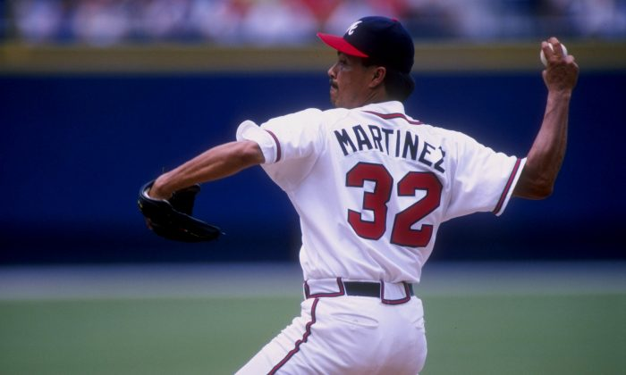 Pitcher Dennis Martinez, aka El Presidente, of the Atlanta Braves in action during a game against the Florida Marlins at Turner Field in Atlanta, Georgia. (Matthew Stockman/Getty Images)