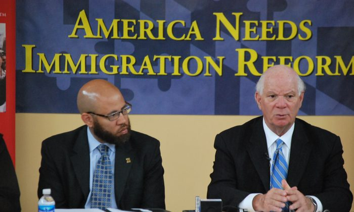 Senator Cardin (D-Md.) (R) speaks with community leaders at an immigration reform roundtable at Casa De Maryland in Hyattville, Md., on May 21. (Ron Dory/The Epoch Times)