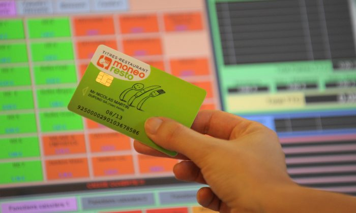 A Moneo Resto smart card from French group Moneo is shown. The United States will soon adopt pin-and-chip technology used in Canadian and European credit cards, which could have prevented the recent cyberheist that hit New York City and other cities around the world. (ERIC PIERMONT/AFP/Getty Images)