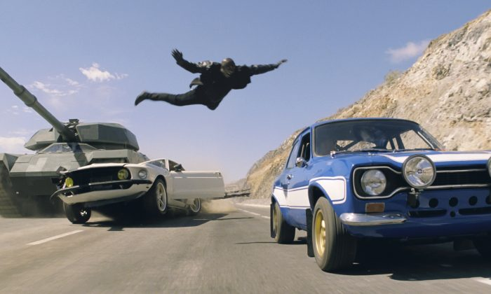 "Roman (Tyrese Gibson) makes a death-defying leap in the action-thriller ""Fast & Furious 6."" Gibson was being a bad father by not spending time with his daughter following a delay in ""Fast & Furious 7"" filming, the mother of the daughter says in court filings. (Courtesy of Universal Pictures)"