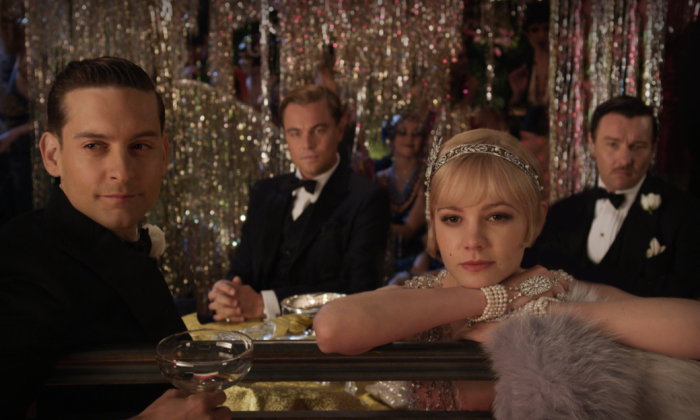"""(L-R) Nick Carraway played by Tobey Maguire, Jay Gatsby (Leonardo DiCaprio), Daisy Buchanan (Cary Mulligan) and Tom Buchanan (Joel Edgerton) the romantic drama """"The Great Gatsby."""" (Warner Bros. Pictures)"""