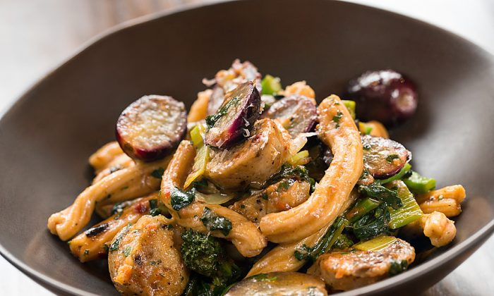 Gemelli con Salsiccia, with house-made chicken sausage, broccoli raab, grapes, and cippollini onions. (Lou Manna Photography)