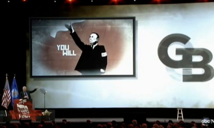 Conservative radio and television show host Glenn Beck (L) gestures to an image of New York Mayor Michael Bloomberg during Beck's keynote address at the National Rifle Association convention in Houston, Texas, on May 4, 2013. (Screenshot/ABC)