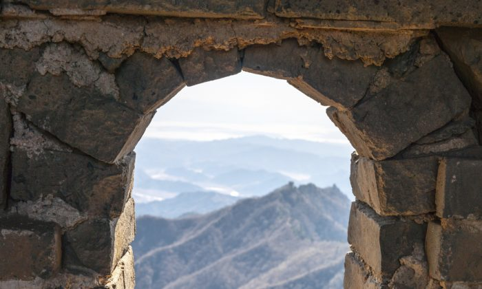 Looking through a window of a watchtower on the Great Wall of China. As soon as soldiers of great courage receive urgent news of an enemy attack, they immediately rush to defend their country, determined to fulfill their duty without hesitation. (Mirko Kirstein/Photos.com)